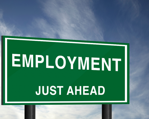 Billboard road sign with the words Employment Just Ahead
