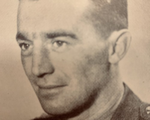 A young John Counsell in military clothing