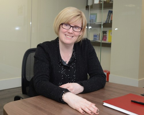 Carla Qualtrough at a desk