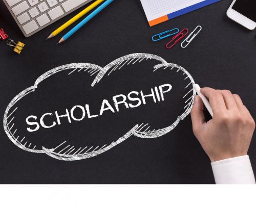 "the word ""scholarship"" written on a desk in chalk"