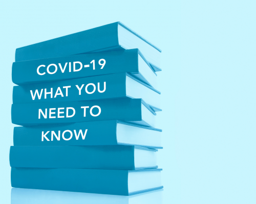 Books stacked on their sides with the words 'Covid-19 What You Need To Know' written on the spines