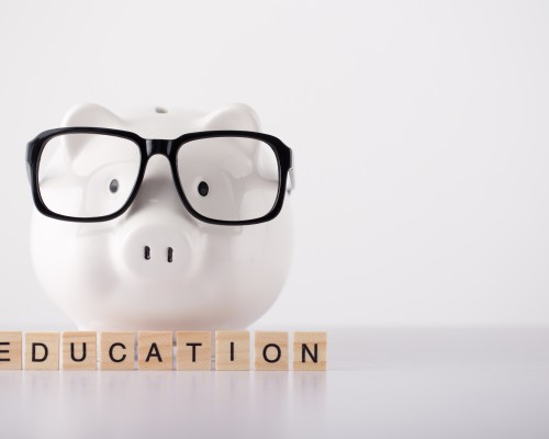 piggly bank with big glasses on the pig and the word 'education' under the pig