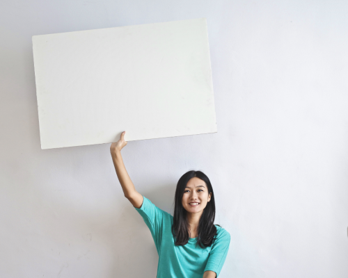 woman holding empty sign as symbol for promotion
