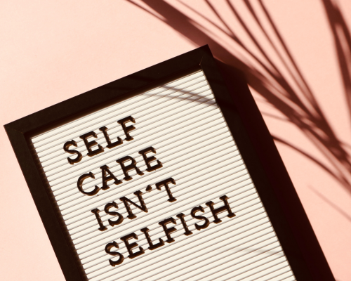 A sign that says self care isn't selfish