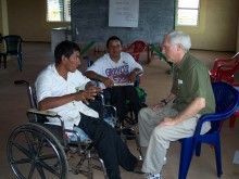 Colleagues in Guyana chat with Bill Adair about issues relating to people with spinal cord injuries