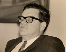head and shoulders shot of Doug Mowat in suit and tie looking left of the camera