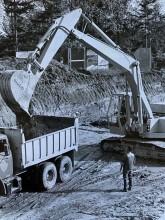 Backhoe working on leveling the ground to build Lyndhurst Hospital